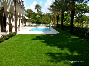 low maintenance backyard with synthetic turf